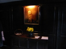 A portrait of Wordsworth's dog hanging in Dove Cottage